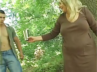 Young dude got proposition from busty experienced woman Sharone Lane to poke her among wild trees